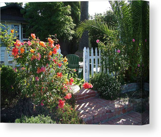 Laguna Cottage Canvas Print featuring the photograph Cottage And Roses by John Loyd Rushing