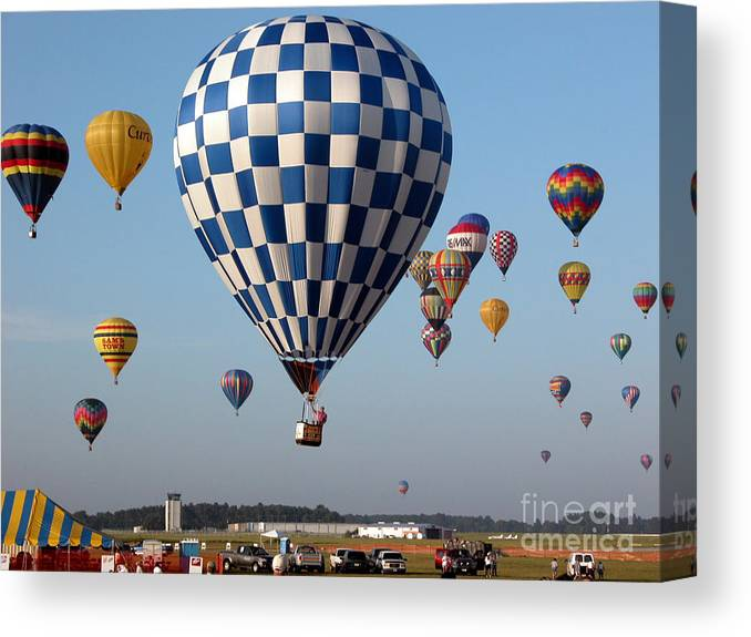 Balloons Canvas Print featuring the photograph Incoming by Paul Anderson