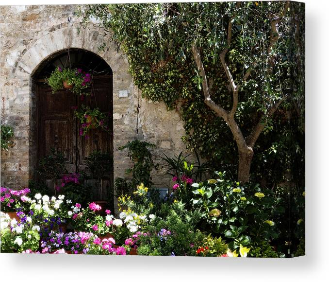 Flower Canvas Print featuring the photograph Italian Front Door Adorned With Flowers by Marilyn Hunt