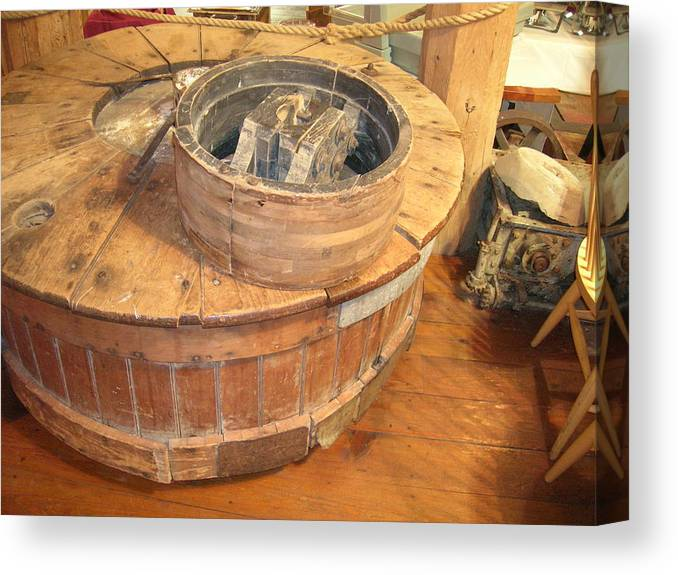 Grinding Wheel Canvas Print featuring the photograph Old Grinding Wheel In A New Environment by Amelia Painter