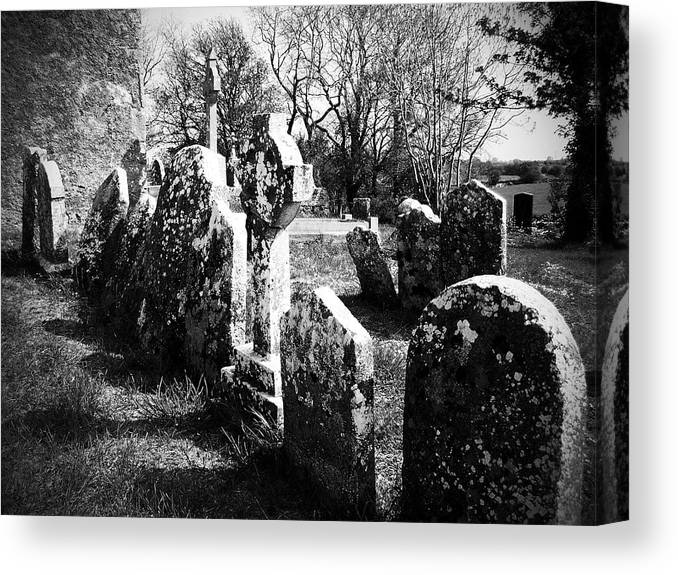 Ireland Canvas Print featuring the photograph Solitary Cross At Fuerty Cemetery Roscommon Irenand by Teresa Mucha