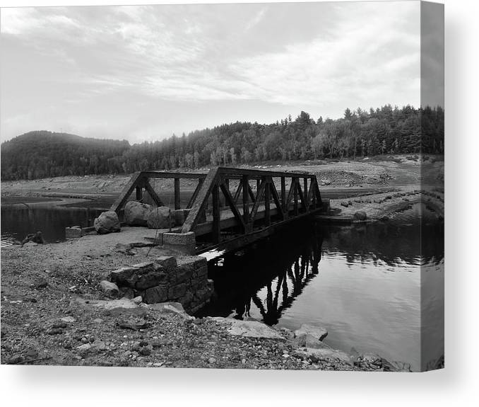 Bridge Water River Monochrome Canvas Print featuring the photograph The Rusted Bridge by Eric Radclyffe
