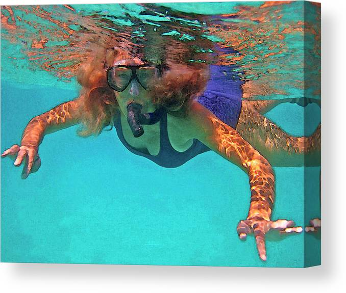 Woman Snorkeling Canvas Print featuring the photograph The Snorkeler by Bette Phelan
