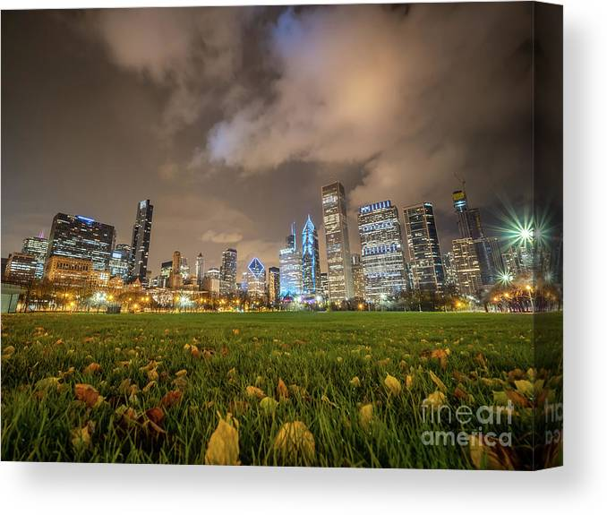 Downtown Canvas Print featuring the photograph Low Angle Picture Of Downtown Chicago Skyline During Winter Nigh by PorqueNo Studios