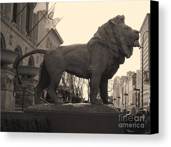 Chicago Canvas Print featuring the photograph Guarded Lion Statue In Chicago by Minding My Visions by Adri and Ray