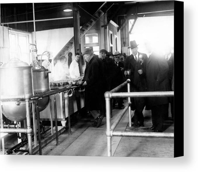 1930s Canvas Print featuring the photograph Men Wait In Line For Food by Everett
