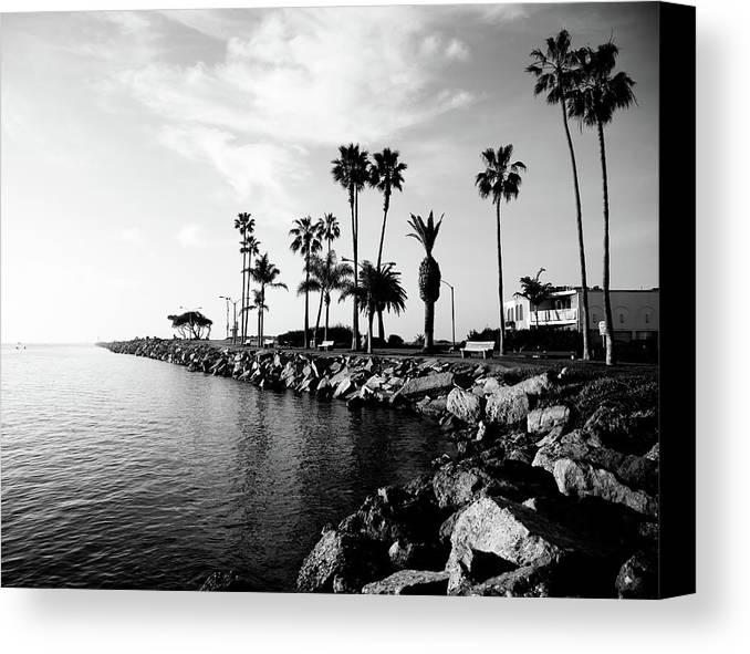 Balboa Peninsula Canvas Print featuring the photograph Newport Beach Jetty by Paul Velgos