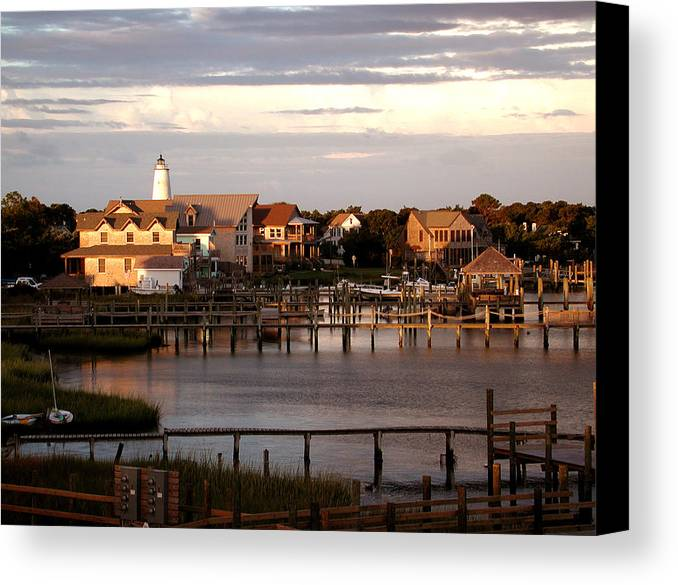 Lighthouse Canvas Print featuring the photograph Okracoke Island Nc Sunrise by Robert Ponzoni