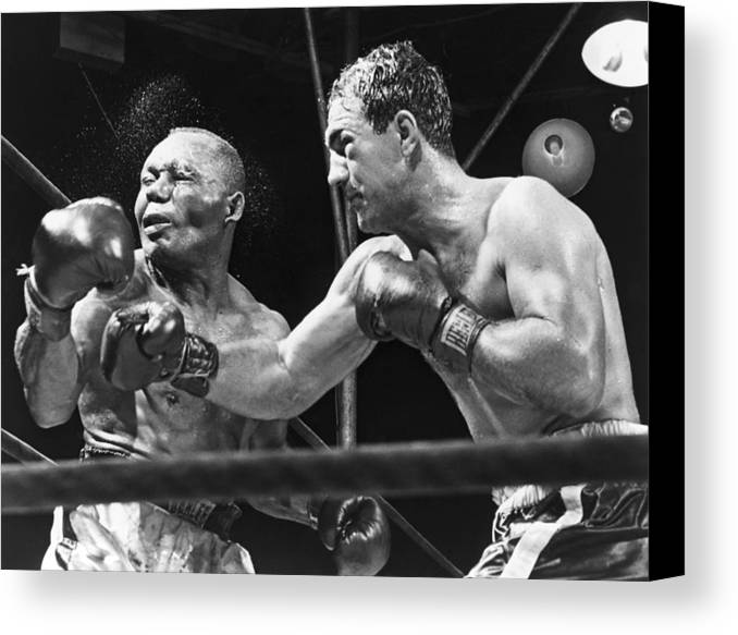 History Canvas Print featuring the photograph Rocky Marciano Landing A Punch by Everett