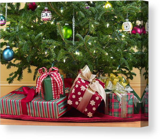 Christmas Tree With Presents.Close Up Of Christmas Tree With Presents Underneath Canvas Print