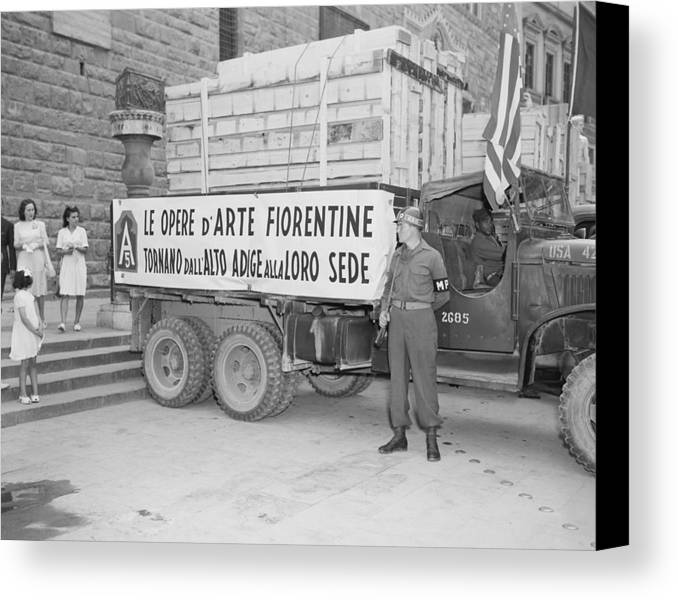 History Canvas Print featuring the photograph U.s. Soldier Guards A Truck Holding by Everett
