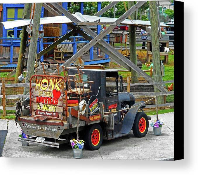 Pigeon Forge Canvas Print featuring the photograph Dysfunction by Ron Kandt