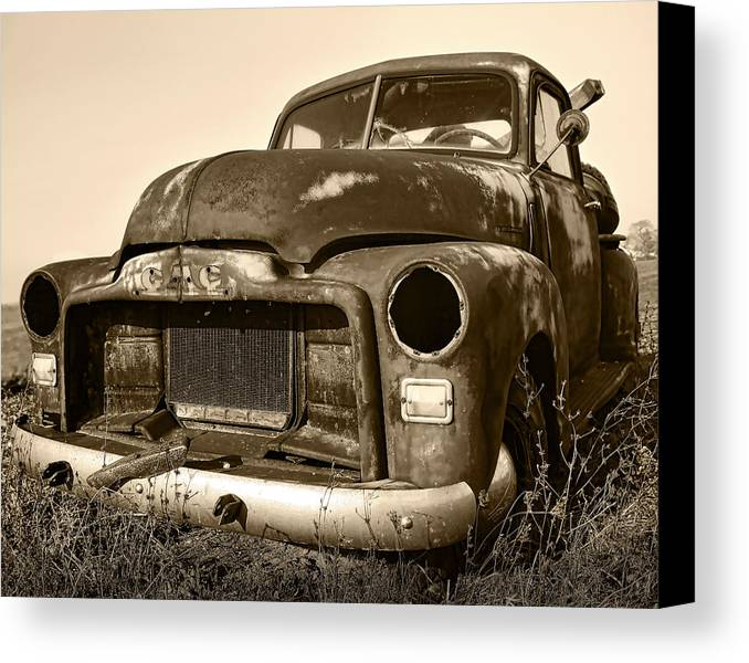 Vintage Canvas Print featuring the photograph Rusty But Trusty Old Gmc Pickup Truck - Sepia by Gordon Dean II