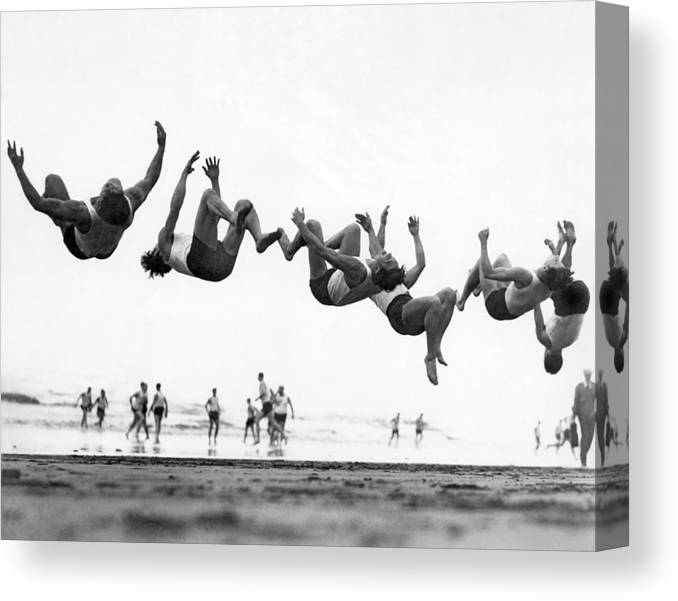 1035-132 Canvas Print featuring the photograph Six Men Doing Beach Flips by Underwood Archives