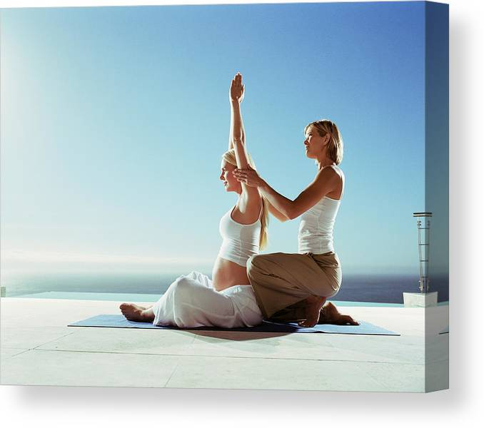 Yoga Teacher Instructing Pregnant Woman Outdoors Canvas Print Canvas Art By Bigshots