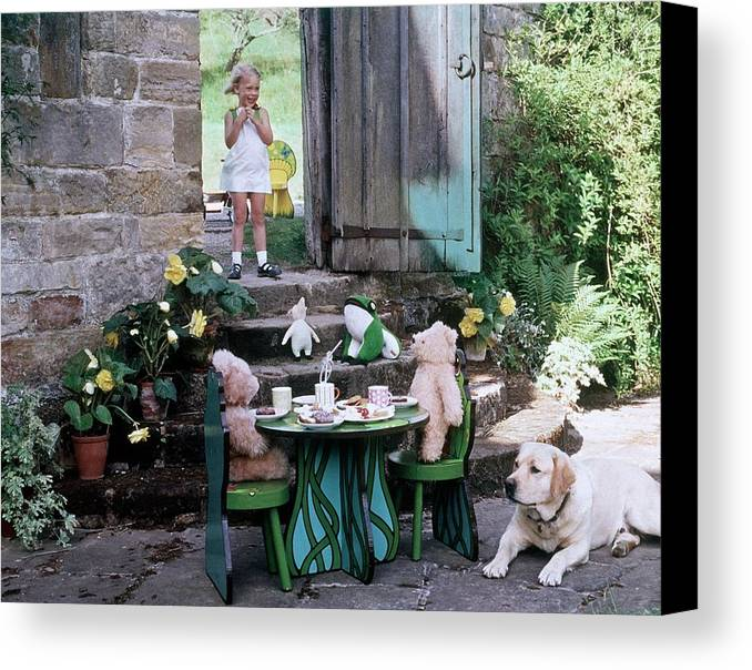 Children Canvas Print featuring the photograph A Dog Sitting Next To Two Teddy Bears Having by Ernst Beadle
