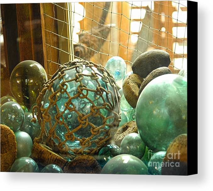 Ocean Floats Canvas Print featuring the photograph Green Glass Japanese Glass Floats by Artist and Photographer Laura Wrede