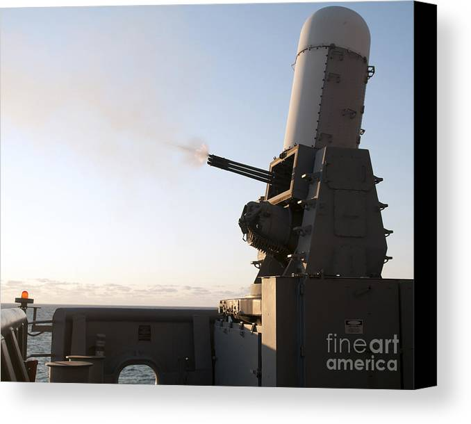 Exercise Bold Alligator Canvas Print featuring the photograph A Close-in Weapons System Fires A Burst by Stocktrek Images