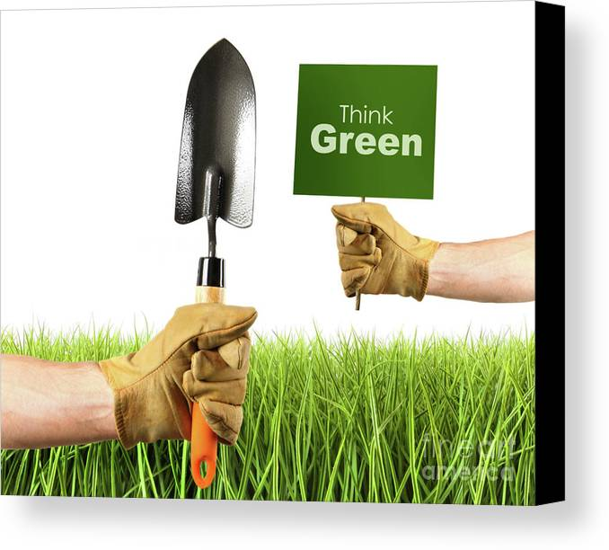 Agriculture Canvas Print featuring the photograph Hands Holding Garden Trowel And Sign by Sandra Cunningham