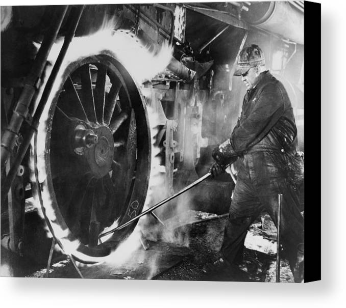History Canvas Print featuring the photograph Railroad Worker Sweating A Tire by Everett