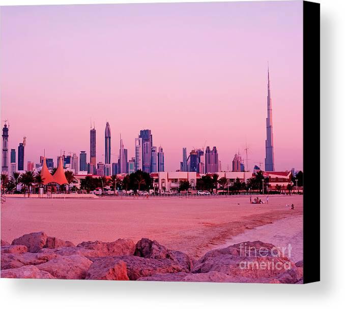 Dubai Canvas Print featuring the photograph Burj Khalifa Previously Burj Dubai At Sunset by Chris Smith