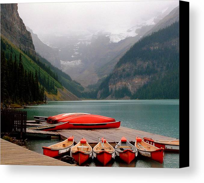 Lake Louise Canvas Print featuring the photograph Nestled Boat Launch by Diane Wallace