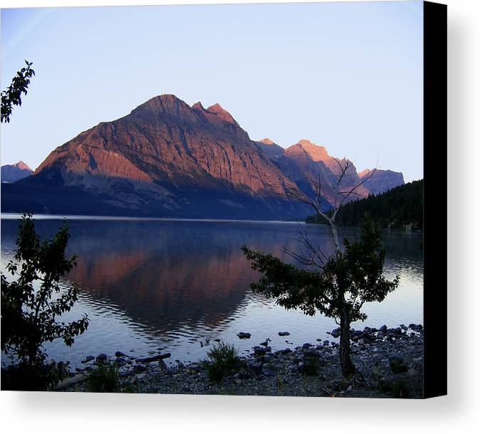 Reflections St. Mary Lake Canvas Print featuring the photograph Red Bluffs by Diane Wallace