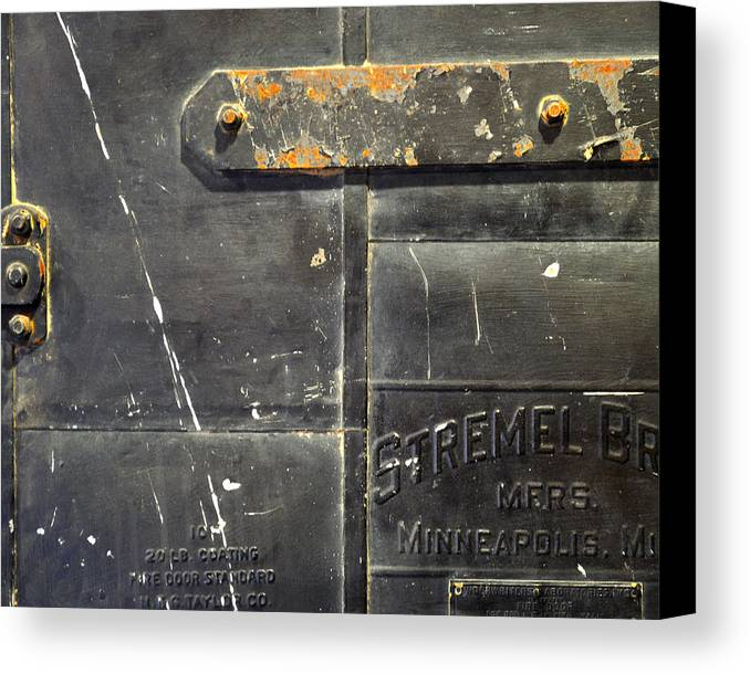 Firedoor Canvas Print featuring the photograph Stremel Bros. Firedoor by Tim Nyberg
