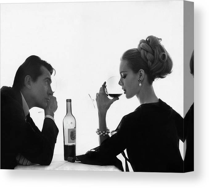 Entertainment Canvas Print featuring the photograph Man Gazing At Woman Sipping Wine by Bert Stern