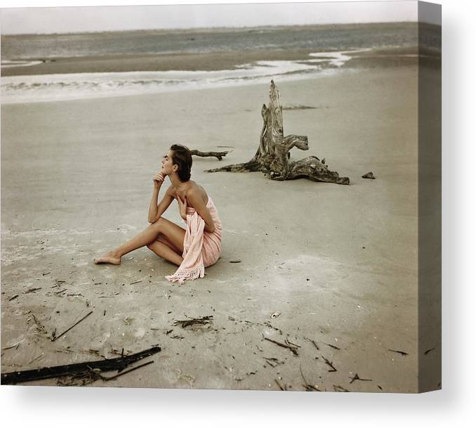One Person Canvas Print featuring the photograph Model Wrapped In A Pink Towel On The Beach by Frances McLaughlin-Gill