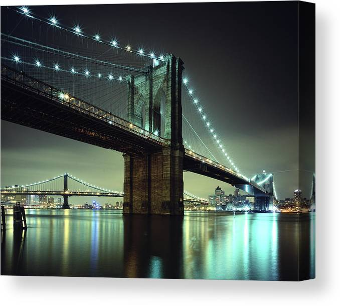 Built Structure Canvas Print featuring the photograph Brooklyn Bridge At Night, New York City by Andrew C Mace