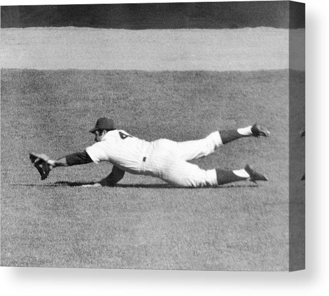 Ninth Inning Canvas Print featuring the photograph Mets Ron Swoboda Dives To Stab Brooks by New York Daily News Archive
