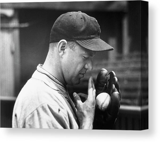 Spitting Canvas Print featuring the photograph Pitcher Burleigh Grimes Demonstrating by Bettmann