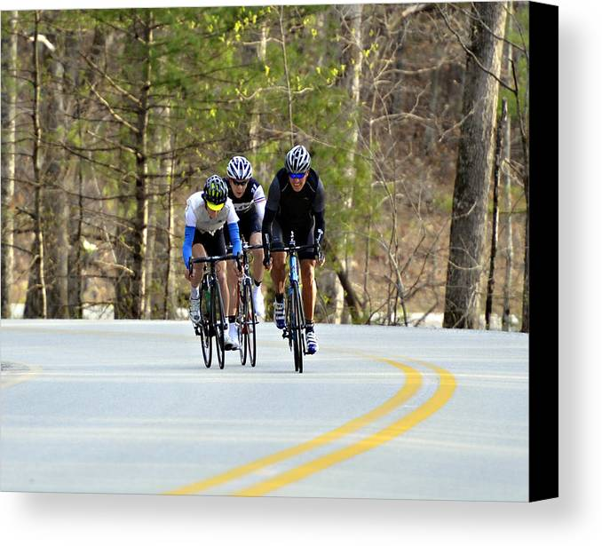Sport Canvas Print featuring the photograph Men In A Bike Race by Susan Leggett