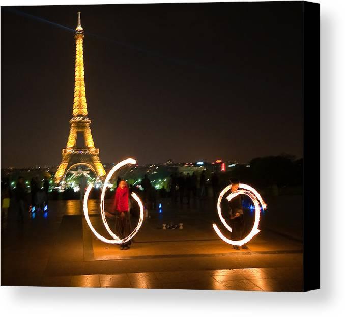 Eiffel Tower Night Nightshot Street Artists Fire Paris France Canvas Print featuring the photograph Street Artists In Paris by Pedro Nunez