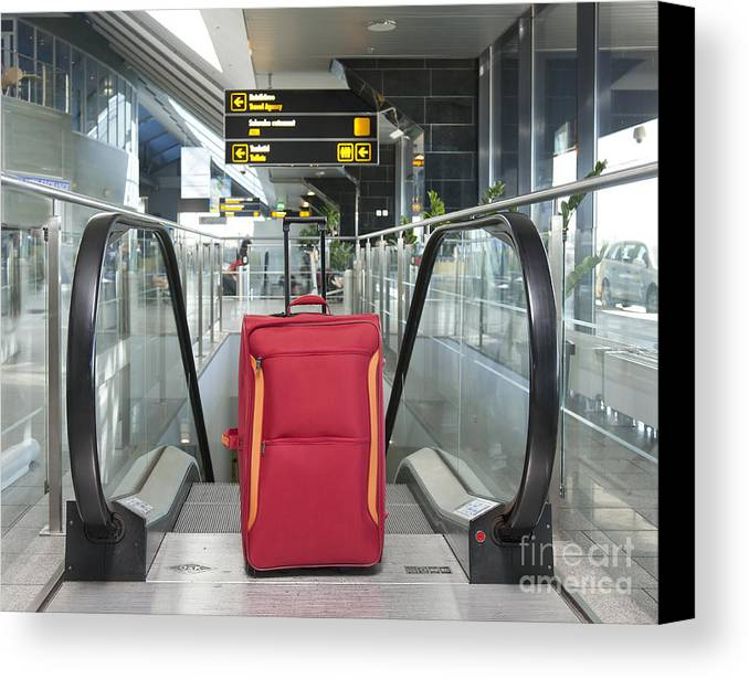Abandoned Canvas Print featuring the photograph Luggage At The Top Of An Escalator by Jaak Nilson