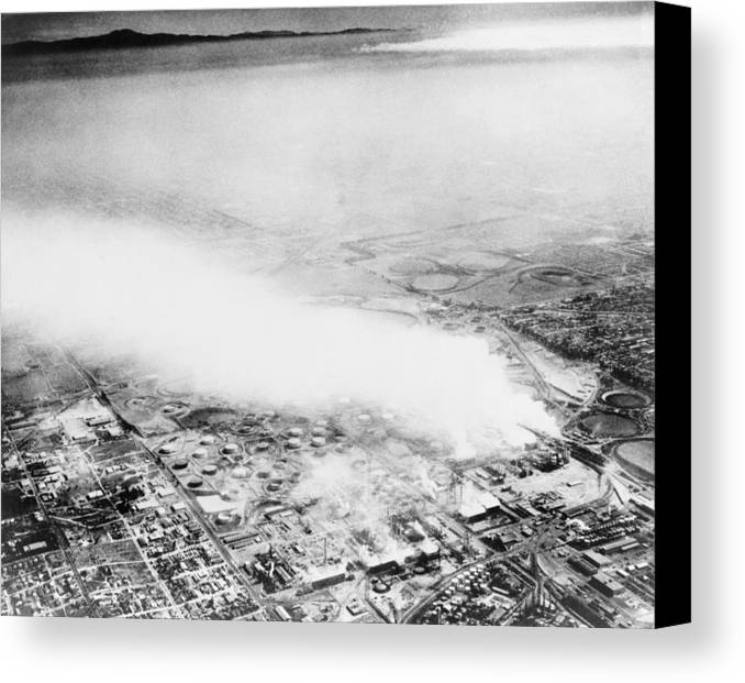 History Canvas Print featuring the photograph Smoke From An Oil Refinery Drifts by Everett