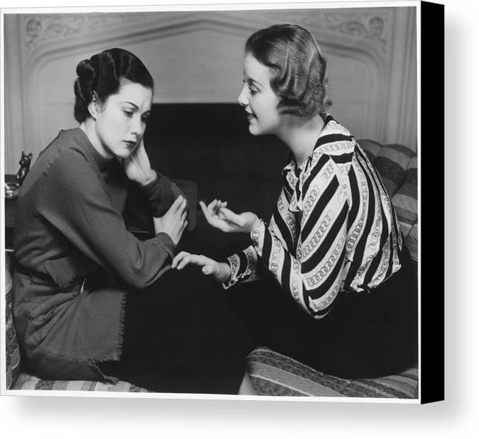 25-29 Years Canvas Print featuring the photograph Woman Consoling Friend At Fireplace, (b&w) by George Marks