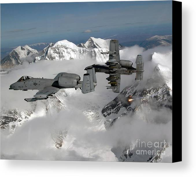 A-10 Canvas Print featuring the photograph A-10 Thunderbolt IIs Fly by Stocktrek Images
