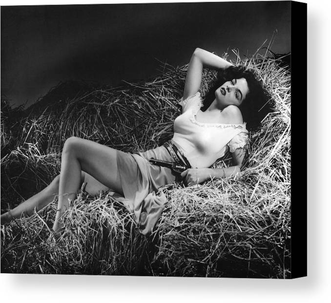 Hollywood Stars Celebrity Canvas Print featuring the photograph Jane Russell In The Outlaw by Peter Nowell