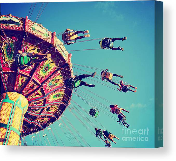 Play Canvas Print featuring the photograph A Swinging Fair Ride At Dusk Toned With by Annette Shaff