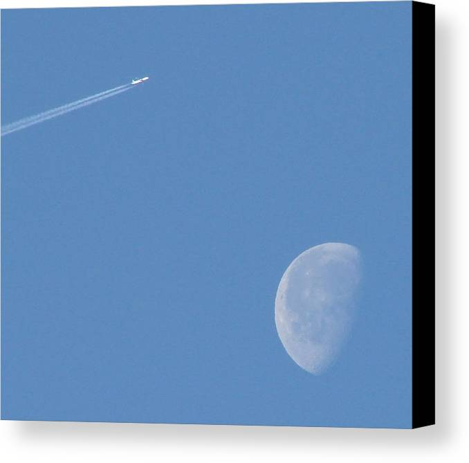 Moon Canvas Print featuring the photograph Flying Over The Moon by Liz Vernand
