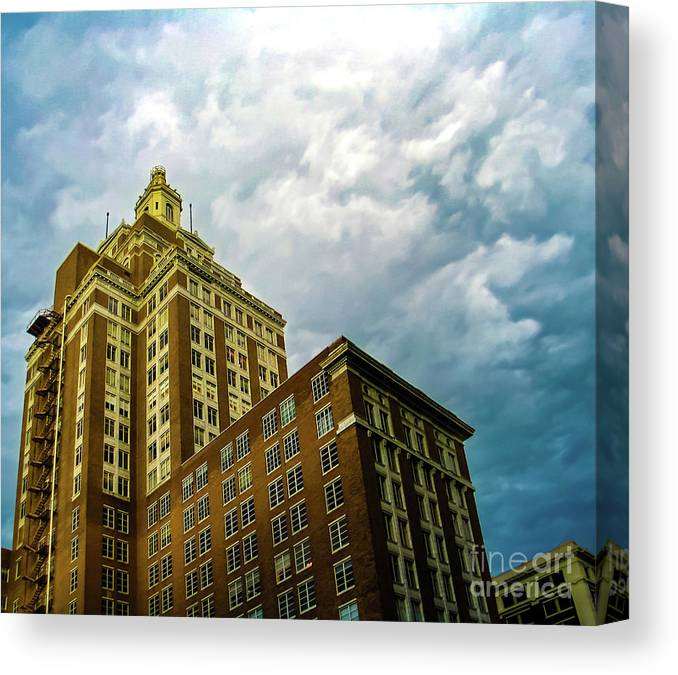 Perspective Of Art Deco Building In Downtown Tulsa Oklahoma Usa On A Stormy  Day With Dramatic Sky Canvas Print