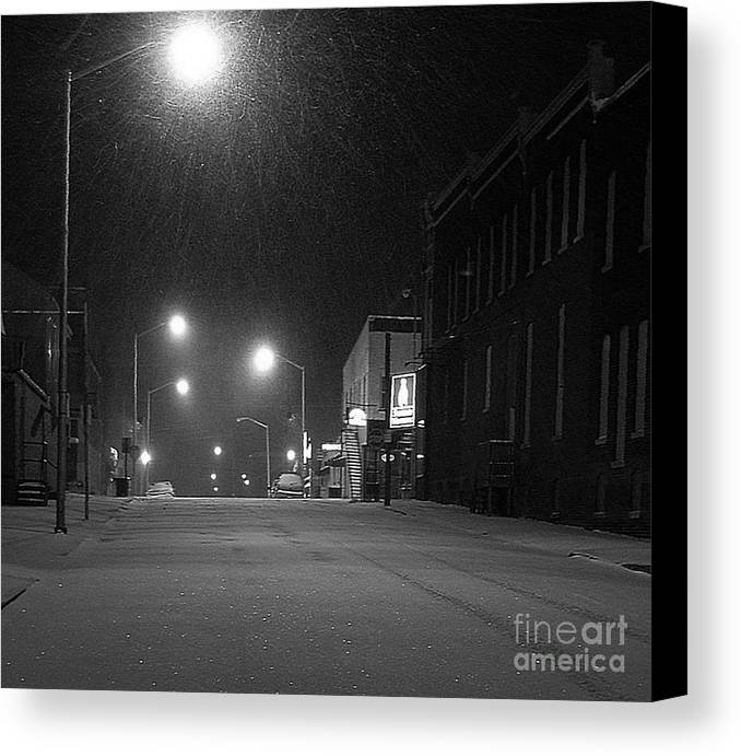 Black And White Photography Canvas Print featuring the photograph Snowing On W. Fourth St. by Julie Dant