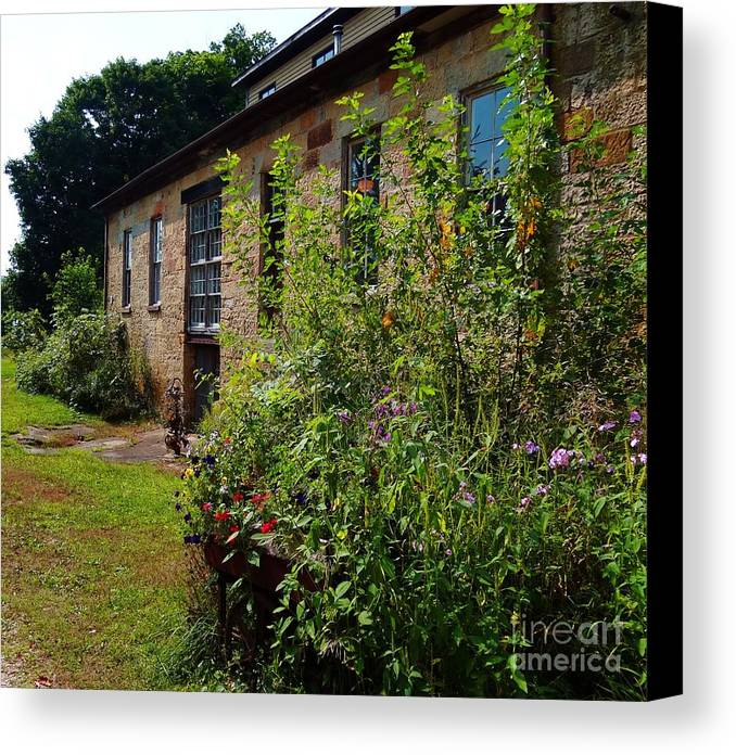 Garden Canvas Print featuring the photograph Pottery Store Garden by Teresa Hayes