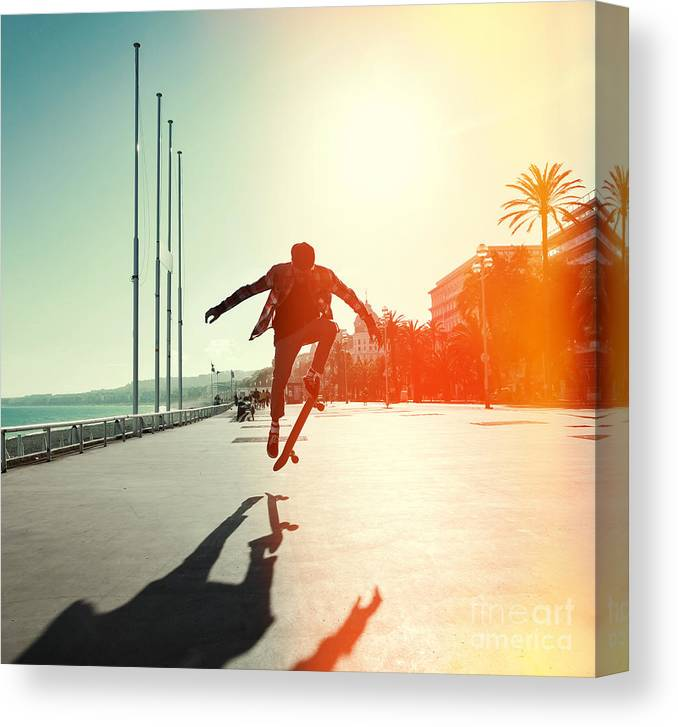 Heat Canvas Print featuring the photograph Silhouette Of Skateboarder Jumping In by Maxim Blinkov