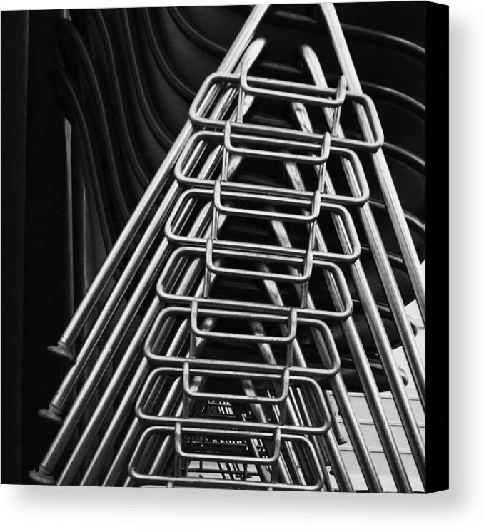 Abstract Canvas Print featuring the photograph Stacks Of Chairs by Anna Villarreal Garbis