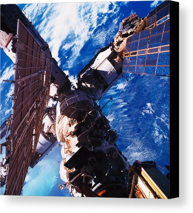 Square Canvas Print featuring the photograph A Space Station Orbiting Above The Earth by Stockbyte