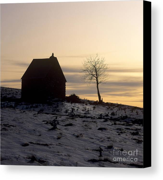 Outdoors Canvas Print featuring the photograph Silhouette Of A Farm And A Tree. Cezallier. Auvergne. France by Bernard Jaubert