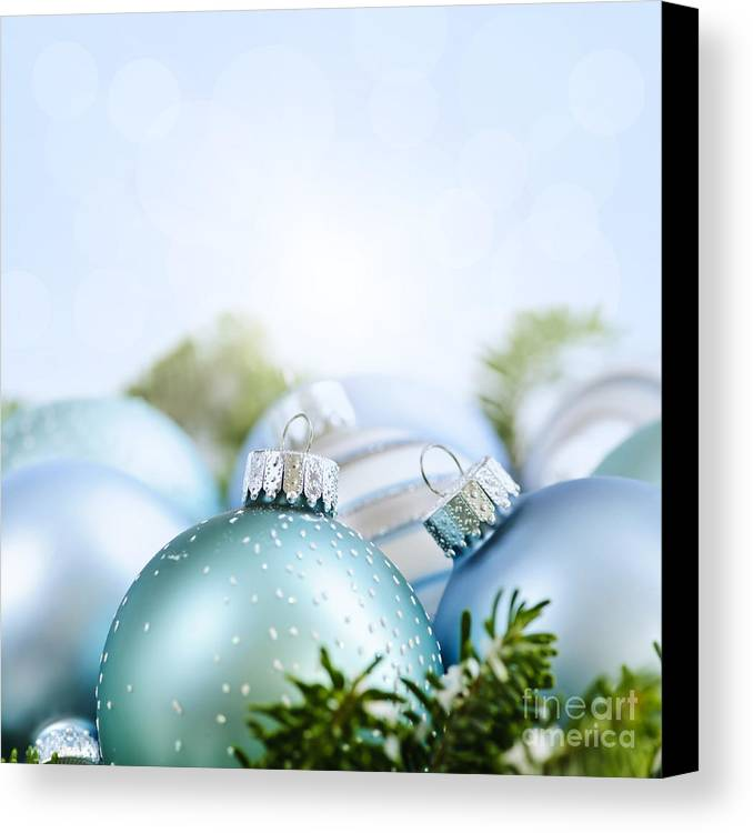 Christmas Canvas Print featuring the photograph Christmas Ornaments On Blue by Elena Elisseeva